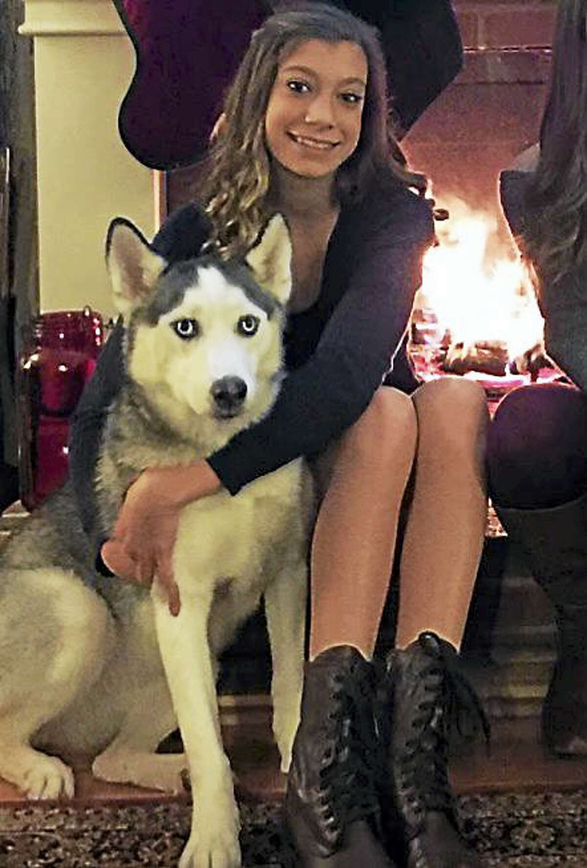 Madi Tranquillo, shown here with her dog, is holding a fundraiser breakfast at Applebee's in Torrington to support her Kindness in Motion project at Region 7 high school on May 6. She's selling tickets and will use the money to create care packages for children who have been placed under DCF care.