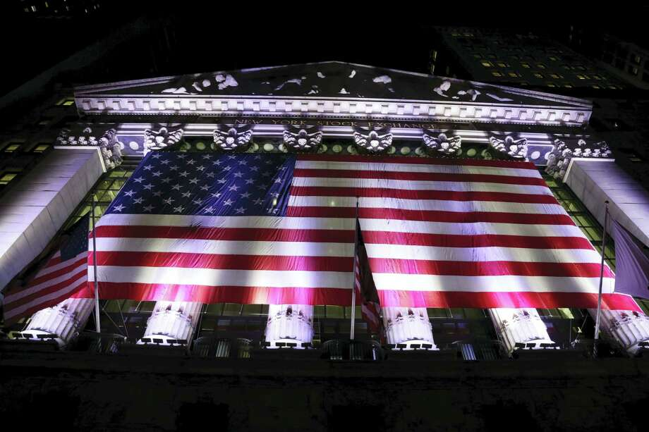 An American flag hangs on the front of the New York Stock Exchange. Photo: Peter Morgan — The Associated Press  / Copyright 2017 The Associated Press. All rights reserved.