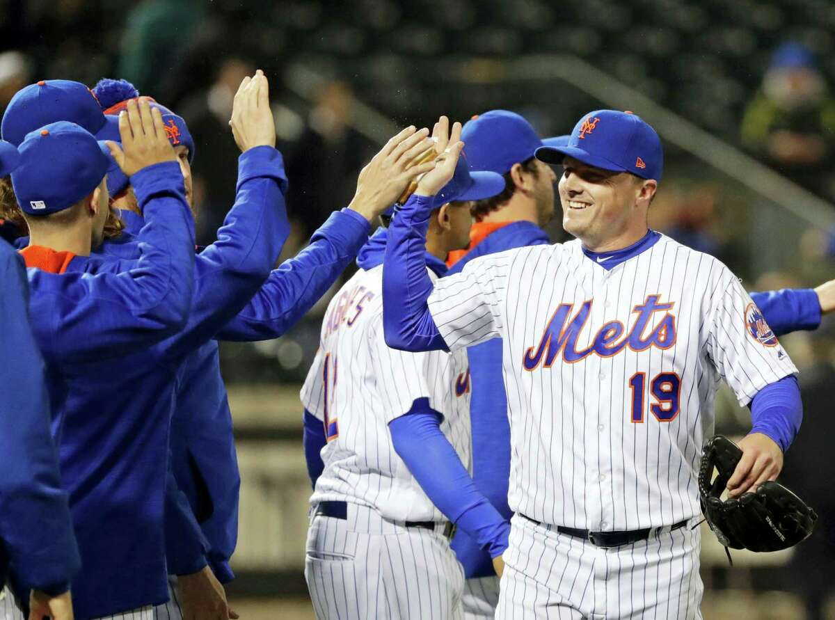 New York Mets' Jay Bruce (19) celebrates with teammates after a baseball game against the Philadelphia Phillies, Wednesday, April 19, 2017, in New York. The Mets won 5-4. (AP Photo/Frank Franklin II)