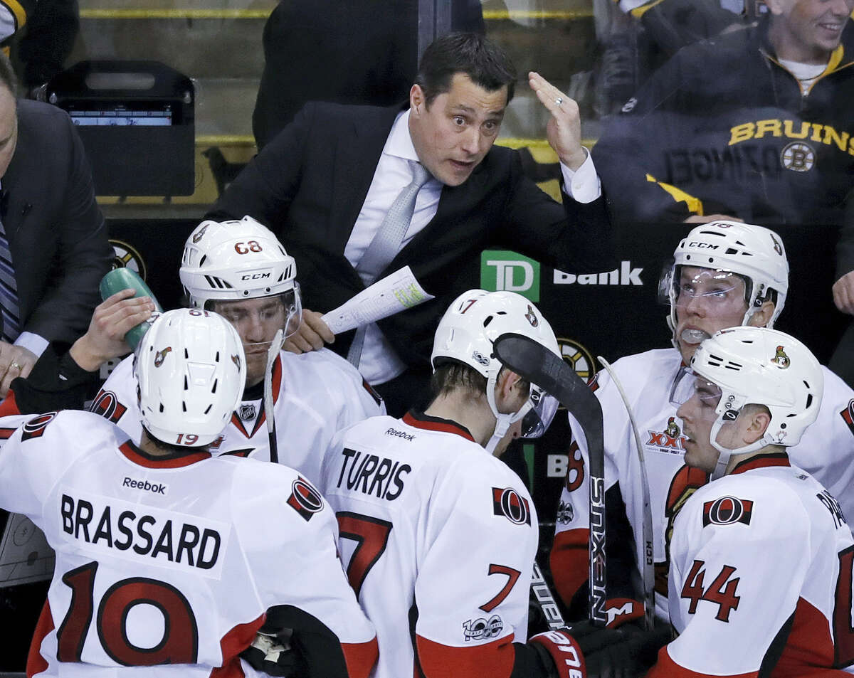 Ottawa Senators head coach Guy Boucher talks to his players during a time out by the Boston Bruins in the third period of Game 4 of a first-round NHL hockey playoff series in Boston, Wednesday, April 19, 2017. The Senators defeated the Bruins 1-0. (AP Photo/Charles Krupa)