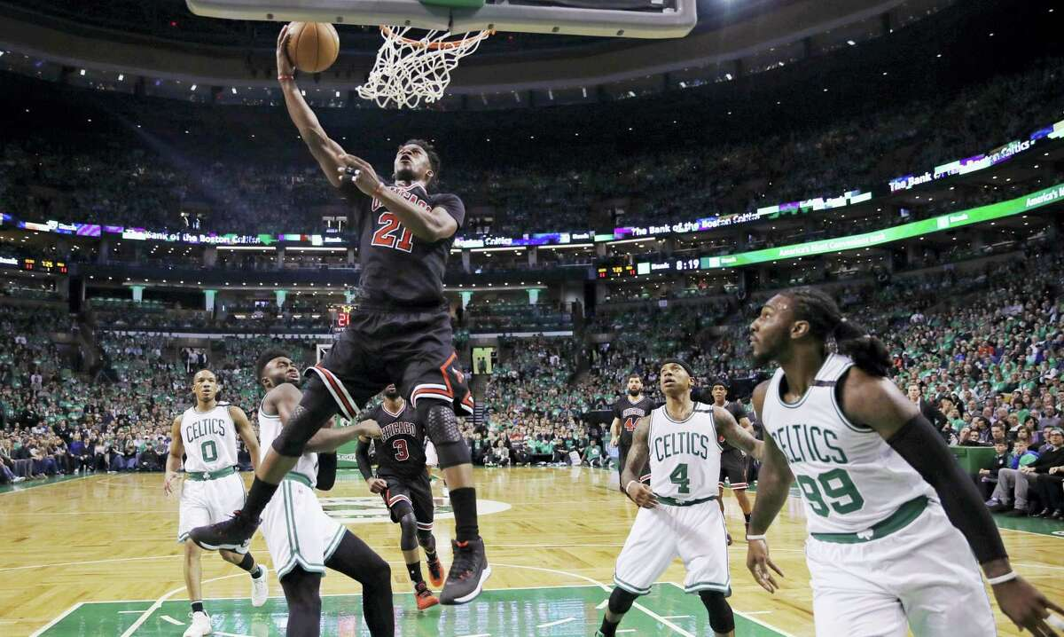 Chicago Bulls forward Jimmy Butler (21) drives to the basket through the Boston Celtics defense in the first quarter of a first-round NBA playoff basketball game in Boston, Tuesday, April 18, 2017. (AP Photo/Charles Krupa)