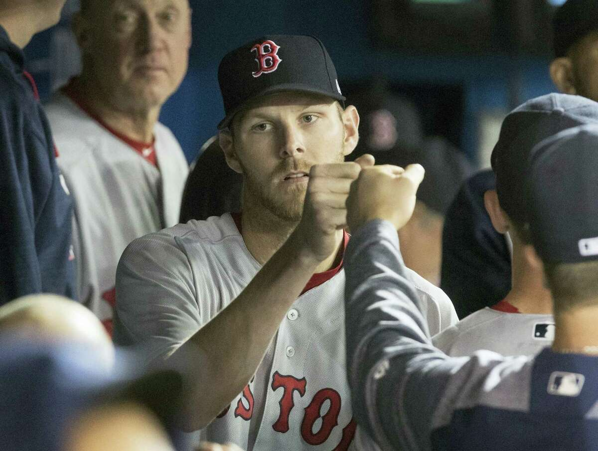 Red Sox starting pitcher Chris Sale is congratulated in dugout during the eighth inning on Thursday.