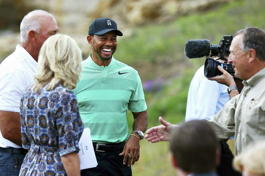 Tiger Woods smiles during a press event for a new golf course designed by Woods, in Hollister, Mo., Tuesday. Photo: Guillermo Martinez — The Springfield News-Leader Via AP  / Guillermo Hernandez Martinez/News-Leader