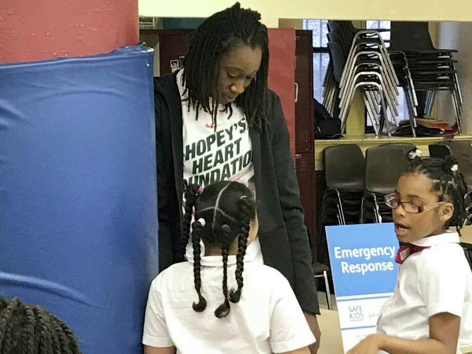 New York Liberty forward Tina Charles talks to students at Thurgood Marshall Academy Lower School on Wednesday in New York. Photo: Doug Feinberg — The Associated Press  / ap
