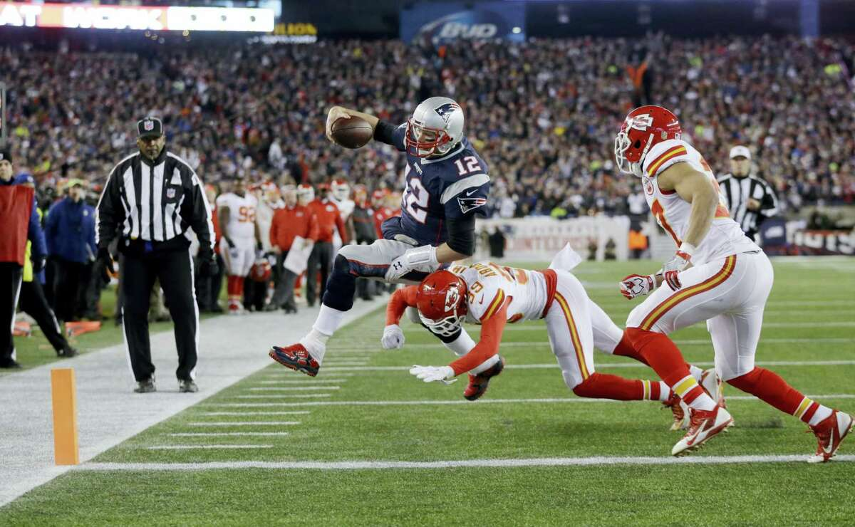 Kansas City Chiefs free safety Husain Abdullah (39) pushes Patriots quarterback Tom Brady out of bounds short of the goal line during a playoff game in Foxborough, Mass.