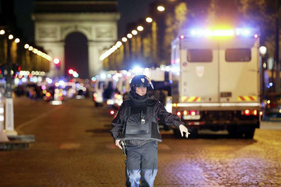 A police officer stands guard after a fatal shooting in which a police officer was killed along with an attacker on the Champs-Elysees in Paris, France, Thursday, April 20, 2017. French media are reporting that two police officers were shot Thursday on the famed shopping boulevard. Many police vehicles can be seen on the avenue that passes many of the city's most iconic landmarks. Photo: AP Photo/Thibault Camus   / Copyright 2017 The Associated Press. All rights reserved.