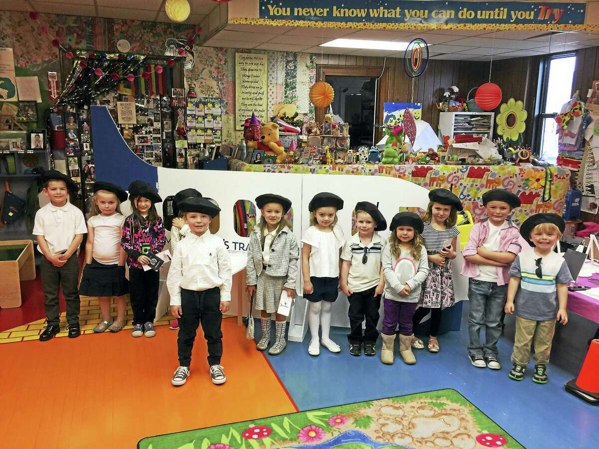 """Students at Miss Stacey's Early Childhood Education Center in Torrington took a """"trip"""" to Paris Thursday morning. The children wore French berets, created passports and learned about traveling to a faraway place."""