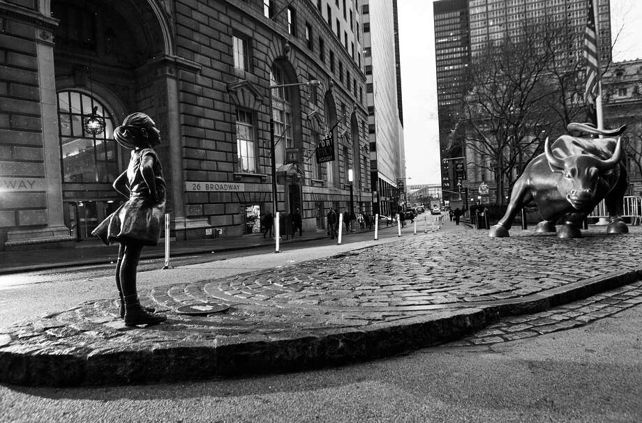 State Street Global Advisors and its advertising agency, McCann New York, have put a statue of a defiant girl across from Wall Street's Charging Bull to draw attention to its efforts to push more companies to put women on boards. MUST CREDIT:  Federica Valabrega. Photo: Federica Valabrega  / The Washington Post