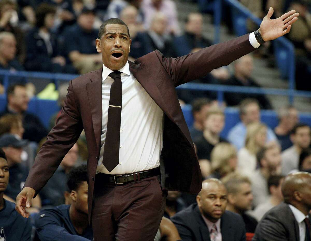 Connecticut head coach Kevin Ollie reacts toward an official in the first half of an NCAA college basketball game against SMU, Saturday, Feb. 25, 2017, in Hartford, Conn. (AP Photo/Jessica Hill)