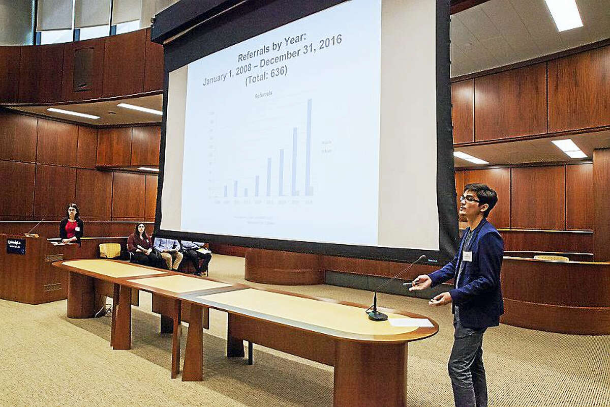 John Sonderegger, a third-year law student at Quinnipiac University School of Law, talks about the rise of referrals of domestic minor sex trafficking in Connecticut at a recent training for hotel and motel staff to learn the signs of sex trafficking in their establishments.