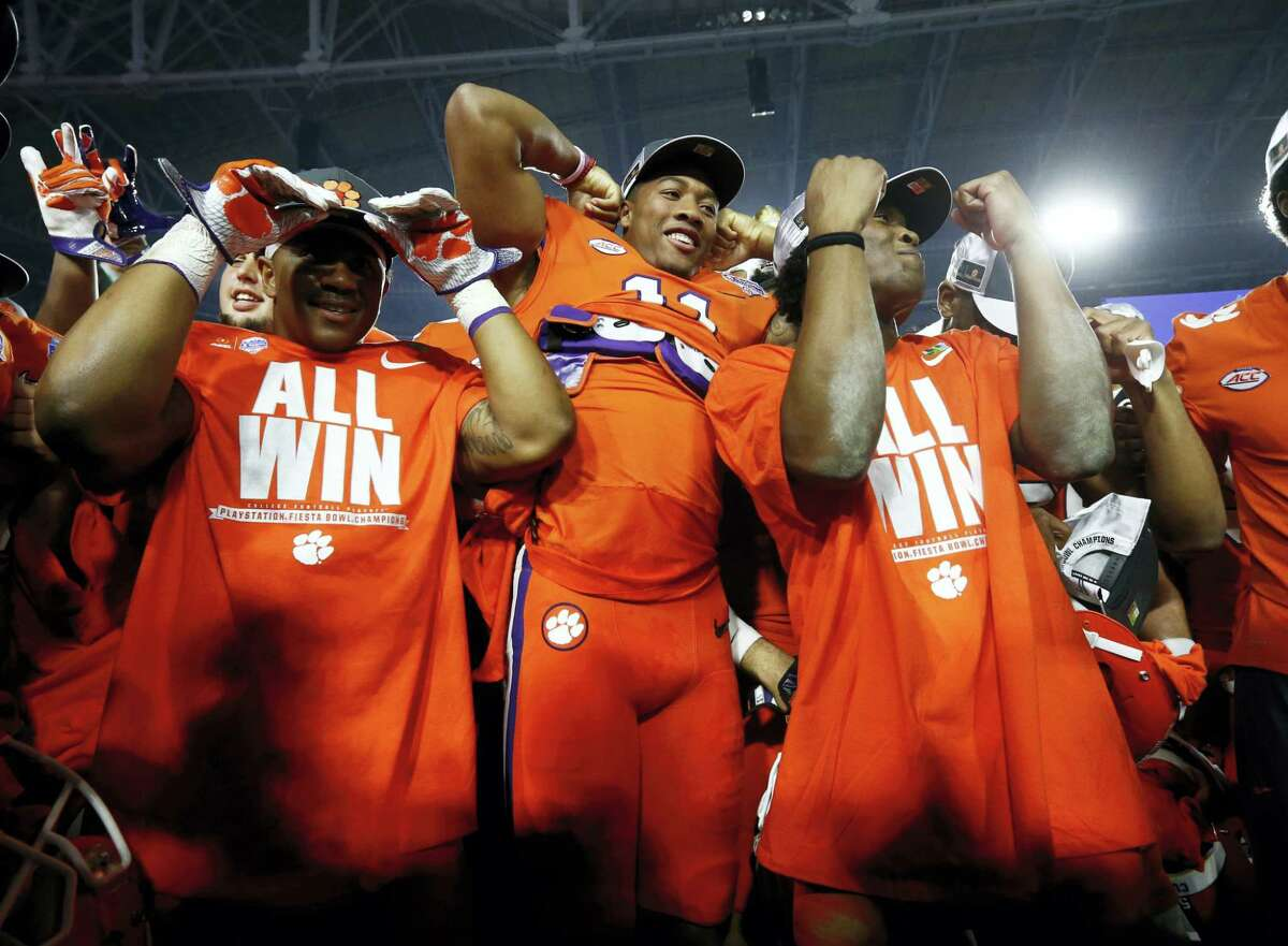 Clemson players celebrate after beating Ohio State 31-0 in the Fiesta Bowl to advance to the national championship game Jan. 9 against Alabama.