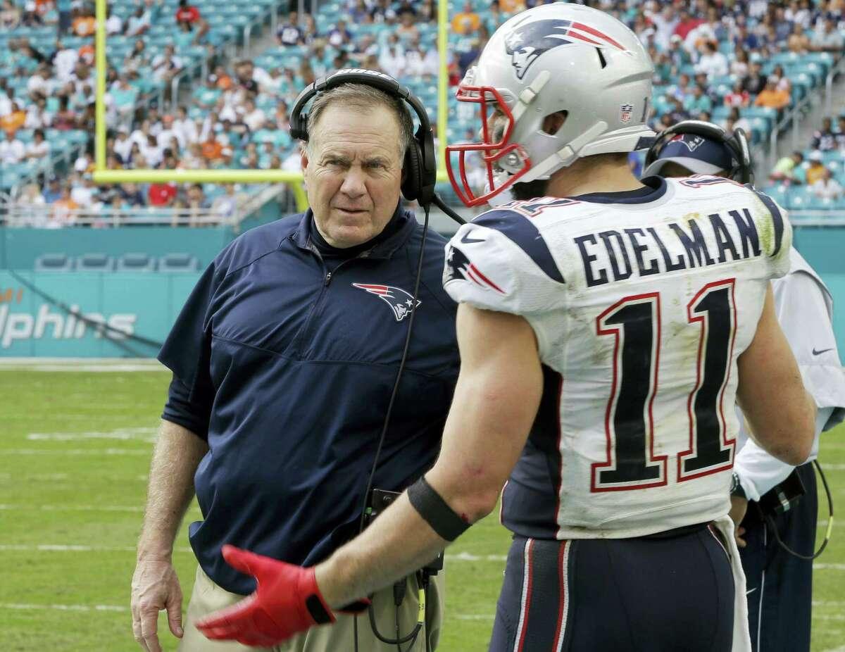 Patriots wide receiver Julian Edelman talks to head coach Bill Belichick.
