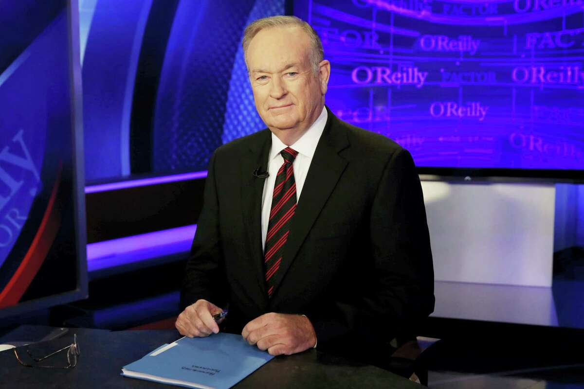 """In this file photo, host Bill O'Reilly of """"The O'Reilly Factor"""" on the Fox News Channel, poses for photos in the set in New York. O'Reilly has lost his job at Fox News Channel following reports that five women had been paid millions of dollars to keep quiet about harassment allegations. 21st Century Fox issued a statement Wednesday that """"after a thorough and careful review of the allegations, the company and Bill O'Reilly have agreed that Bill O'Reilly will not be returning to the Fox News Channel."""