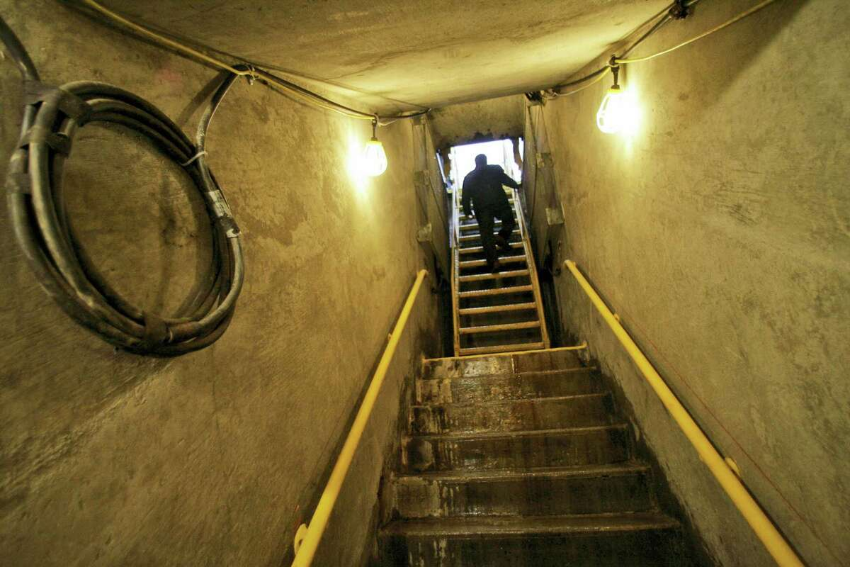 FILE- In this file photo, a Metropolitan Transit Authority employee climbs the stairs to the street from the partly finished track of the 2nd Avenue subway prior to the ground breaking ceremony in New York. Construction first started 45 years ago, but New Yorkers' long wait to take a subway under Manhattan's far Upper East Side ends at noon Sunday when a stretch of the new Second Avenue line is set to open to the public.