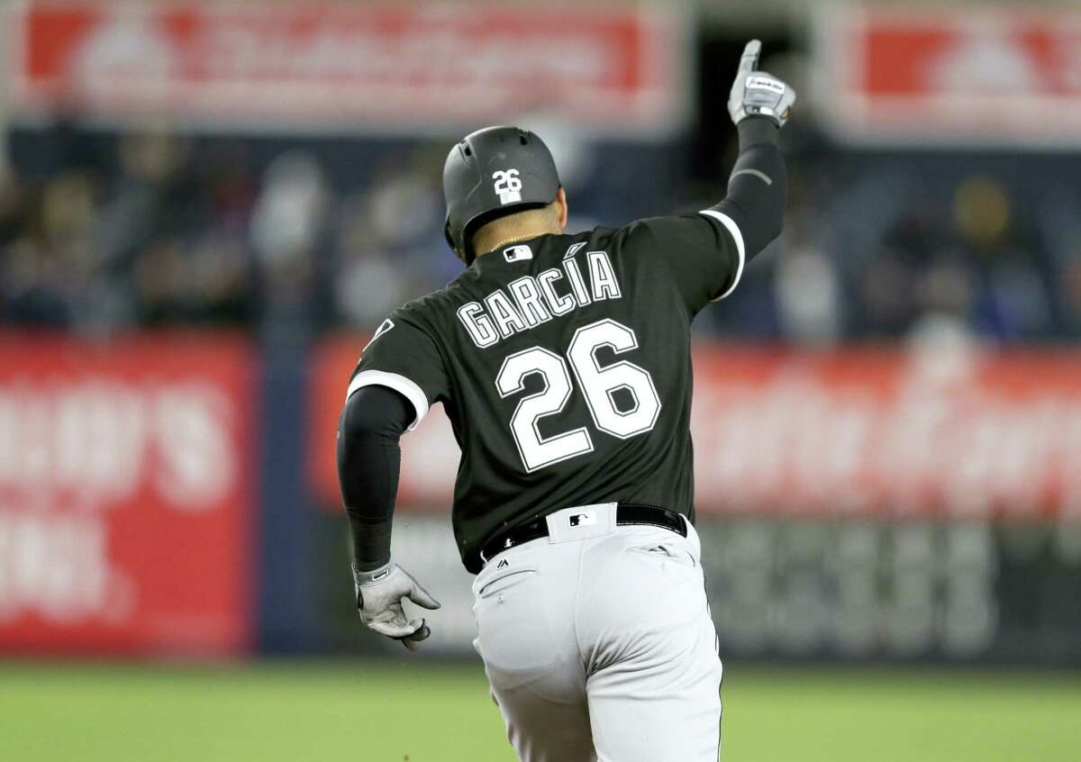 Chicago White Sox's Avisail Garcia points while rounding the bases after hitting a three-run home run during the seventh inning of the team's baseball game against the New York Yankees at Yankee Stadium Tuesday. The White Sox win 4-1.