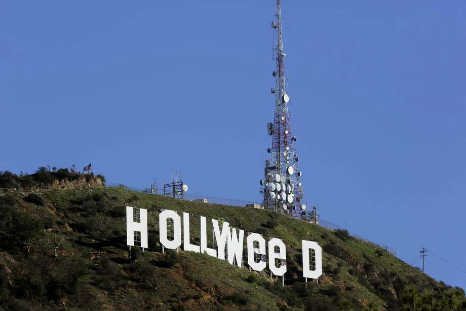 """The Hollywood sign is seen vandalized Sunday. Los Angeles residents awoke New Year's Day to find a prankster had altered the famed Hollywood sign to read """"HOLLYWeeD."""" Police have notified the city's Department of General Services, whose officers patrol Griffith Park and the area of the rugged Hollywood Hills near the sign. California voters in November approved Proposition 64, which legalized the recreational use of marijuana, beginning in 2018. Photo: Damian Dovarganes — The Associated Press  / Copyright 2017 The Associated Press. All rights reserved."""