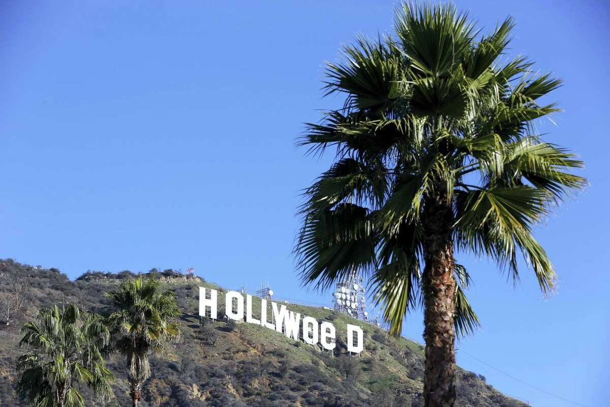 """The Hollywood sign is seen vandalized Sunday. Los Angeles residents awoke New Year's Day to find a prankster had altered the famed Hollywood sign to read """"HOLLYWeeD."""" Police have notified the city's Department of General Services, whose officers patrol Griffith Park and the area of the rugged Hollywood Hills near the sign. California voters in November approved Proposition 64, which legalized the recreational use of marijuana, beginning in 2018."""
