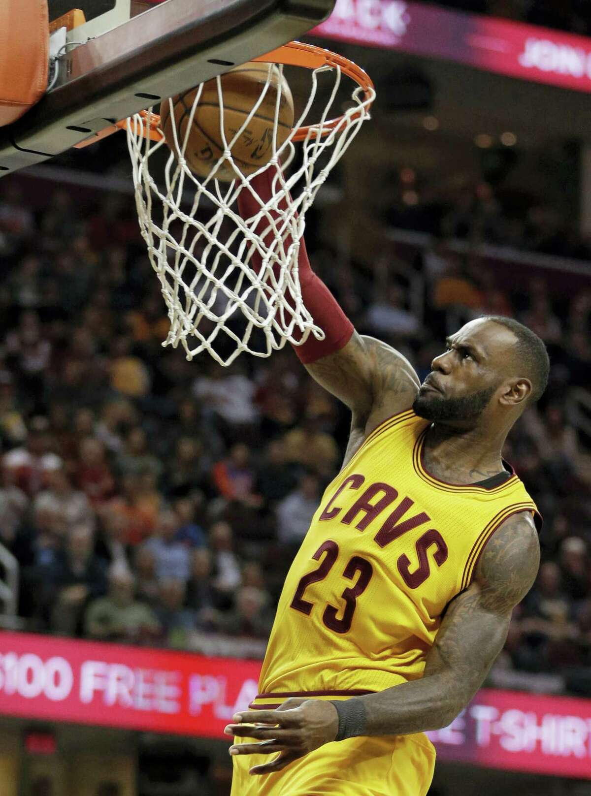 Cleveland Cavaliers' LeBron James dunks against the Milwaukee Bucks in the first half of an NBA basketball game on Feb. 27, 2017 in Cleveland. The Cavaliers won 102-95.