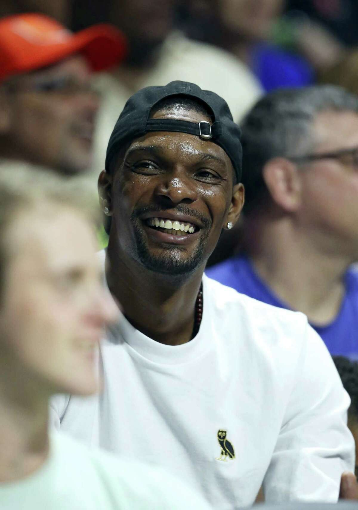 Miami Heat forward Chris Bosh smiles during the first half of an NCAA college basketball game between Miami and Duke in Coral Gables, Fla., on Feb. 25, 2017.