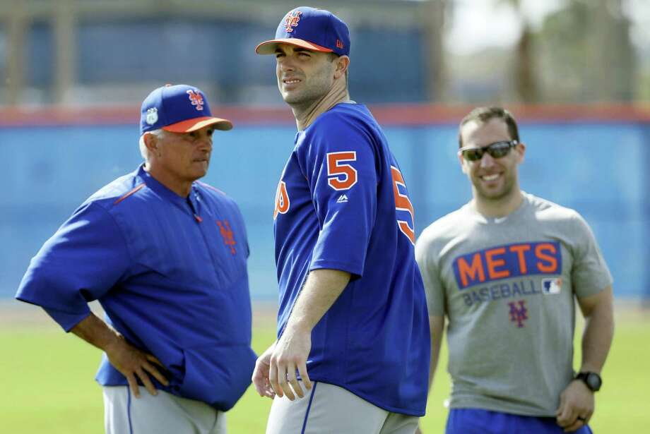 In this Feb. 15, 2017 photo, New York Mets third baseman David Wright (5) looks on along with manager Terry Collins, left, during a spring training baseball workout in Port St. Lucie, Fla. Wright has returned from spring training to New York, because of impingement in his right shoulder. The team says the third baseman was examined Feb. 28, 2017 at the Hospital for Special Surgery after feeling discomfort and was told not to throw for two weeks. Photo: AP Photo — David J. Phillip, File  / Copyright 2017 The Associated Press. All rights reserved.