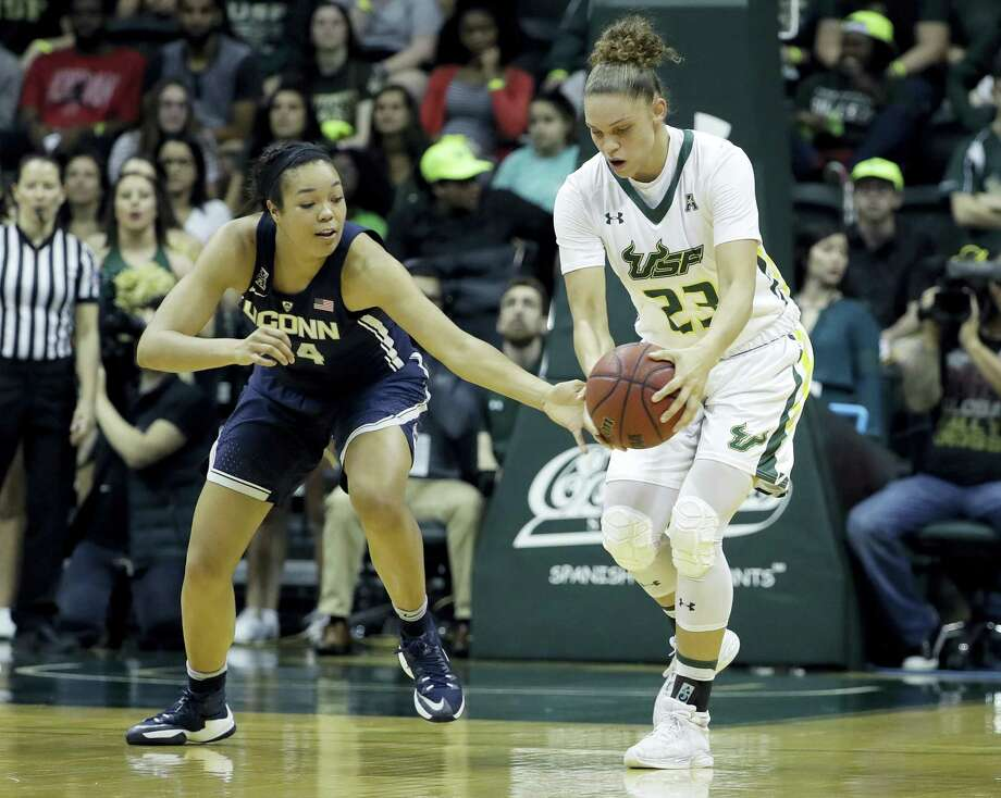 Connecticut guard/forward Napheesa Collier (24) tries to steal the ball from South Florida forward Tamara Henshaw (23) during the first half of an NCAA women's college basketball game, Monday, Feb. 27, 2017, in Tampa, Fla. (AP Photo/Chris O'Meara) Photo: AP / Copyright 2017 The Associated Press. All rights reserved.