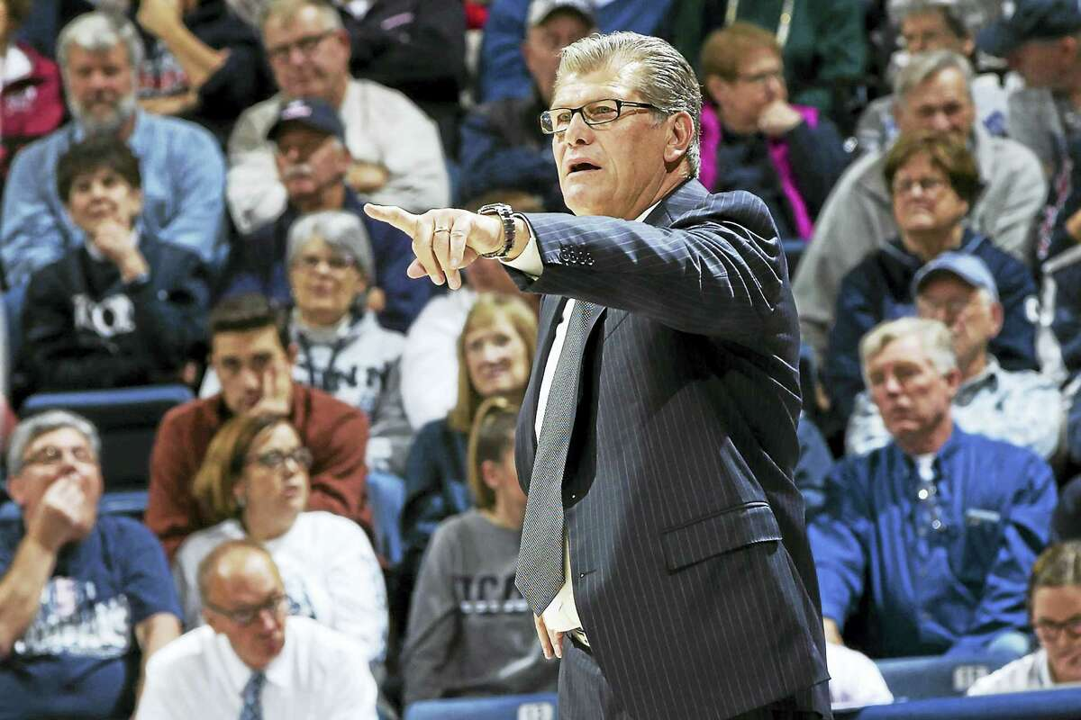 Head coach Geno Auriemma makes a point on the sidelines.