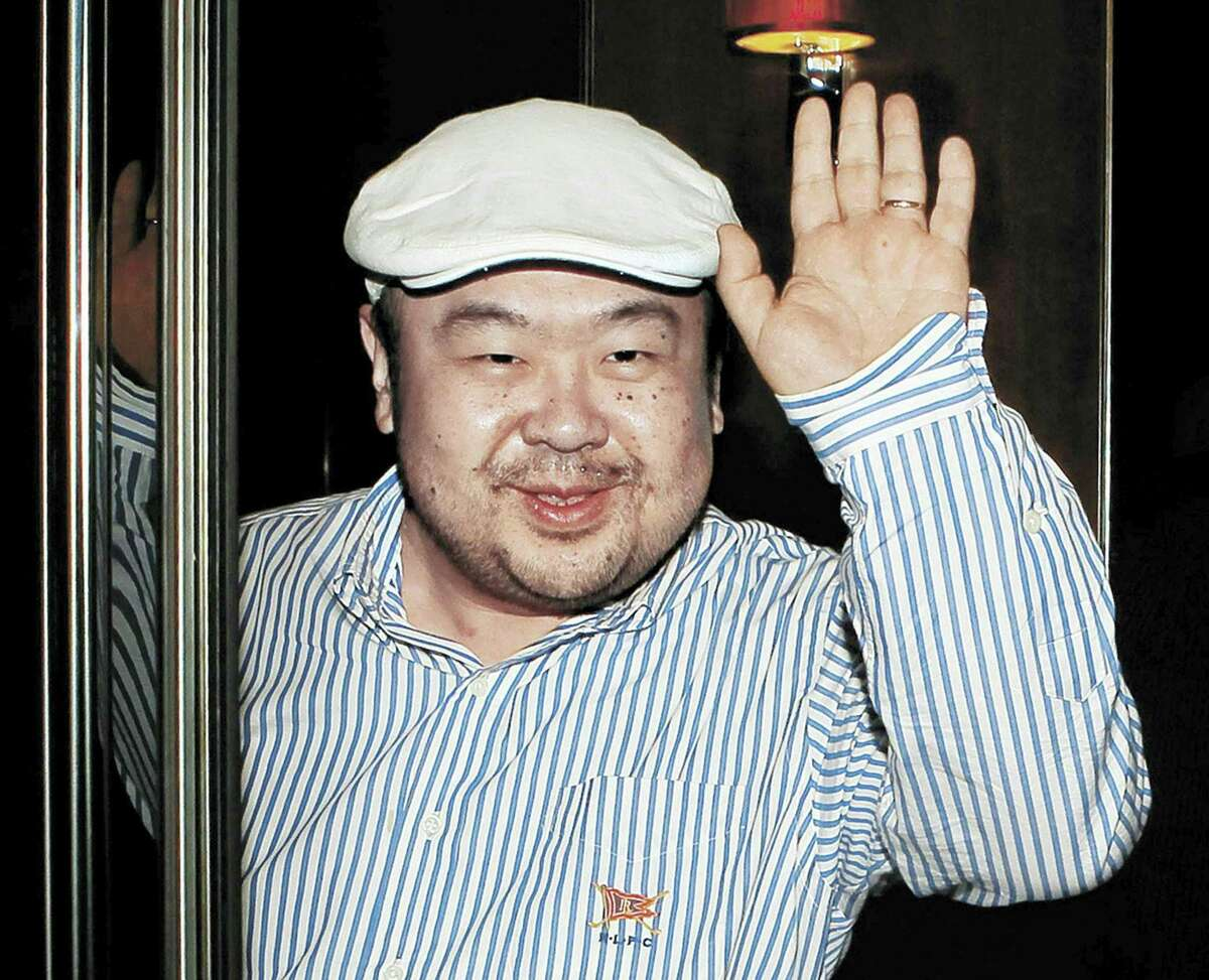 In this June 4, 2010, file photo, dressed in jeans and blue suede loafers, Kim Jong Nam, the eldest son of then North Korean leader Kim Jong Il, waves after his first-ever interview with South Korean media in Macau. Kim Jong Nam had spent years in exile, gambling and drinking and arranging the occasional business deal as he traveled across Asia and Europe. His fortunes had apparently declined in recent years, and he'd moved his family from a luxurious seafront condominium complex in Macau to a more affordable apartment building.