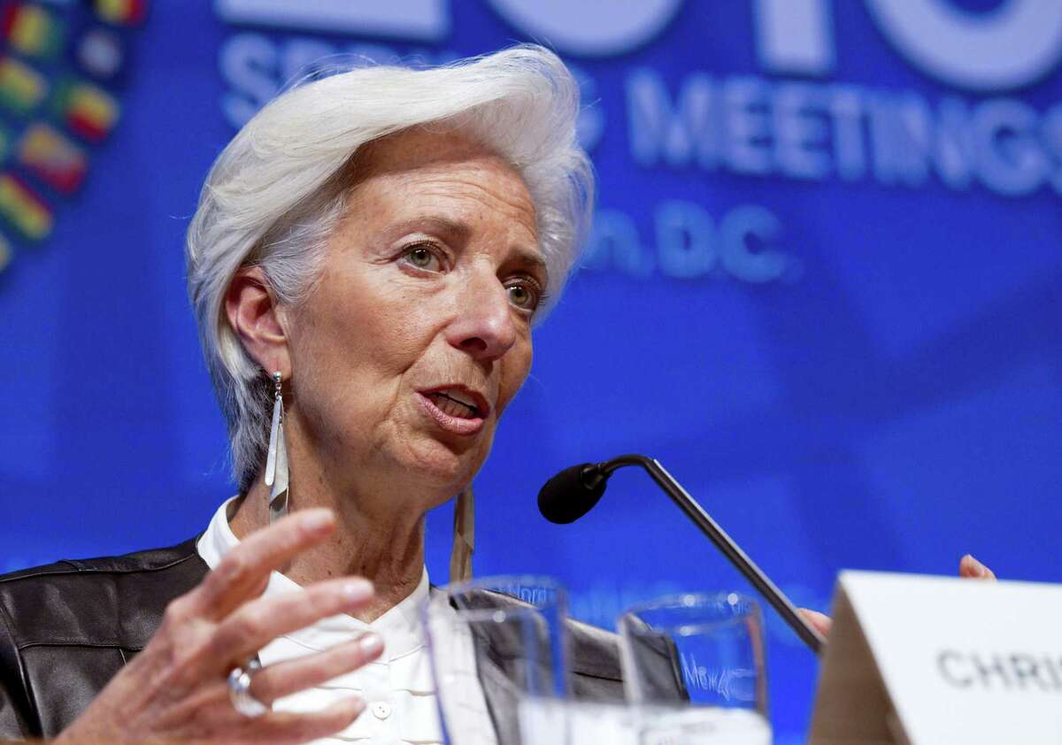 In this April 16, 2016 photo, International Monetary Fund Managing Director Christine Lagarde speaks during a news conference after the International Monetary and Financial Committee (IMFC) conference at the World Bank/IMF Spring Meetings at IMF headquarters in Washington. A resilient China, rising commodity prices and sturdy financial markets are offering a sunnier outlook for the global economy and helping dispel the gloom that has lingered since the Great Recession ended, according to the IMF, which predicts that the world economy will grow 3.5 percent in 2017, up from 3.1 percent in 2016.