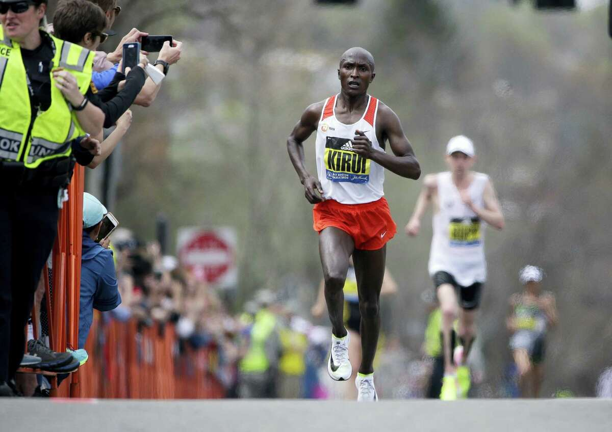 Geoffrey Kirui of Kenya leads Galen Rupp, of the United States, and the rest of the field along the course of the 121st Boston Marathon on April 17, 2017 in Brookline, Mass.