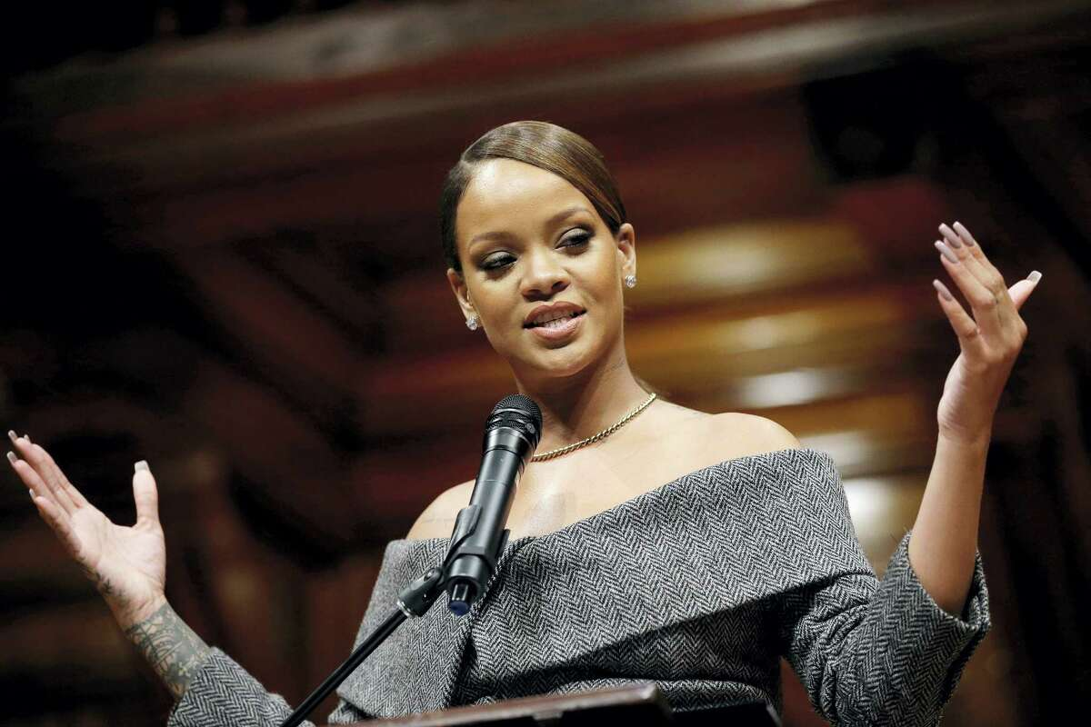 Singer Rihanna addresses an audience after being presented with the 2017 Harvard University Humanitarian of the Year Award during ceremonies Feb. 28, 2017, at the Sanders Theatre on the school's campus, in Cambridge, Mass.
