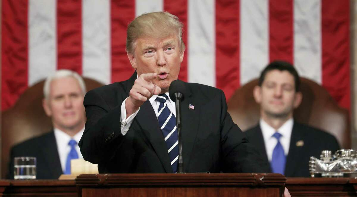President Donald Trump addresses a joint session of Congress on Capitol Hill in Washington Tuesday. Vice President Mike Pence and House Speaker Paul Ryan of Wis. listen.