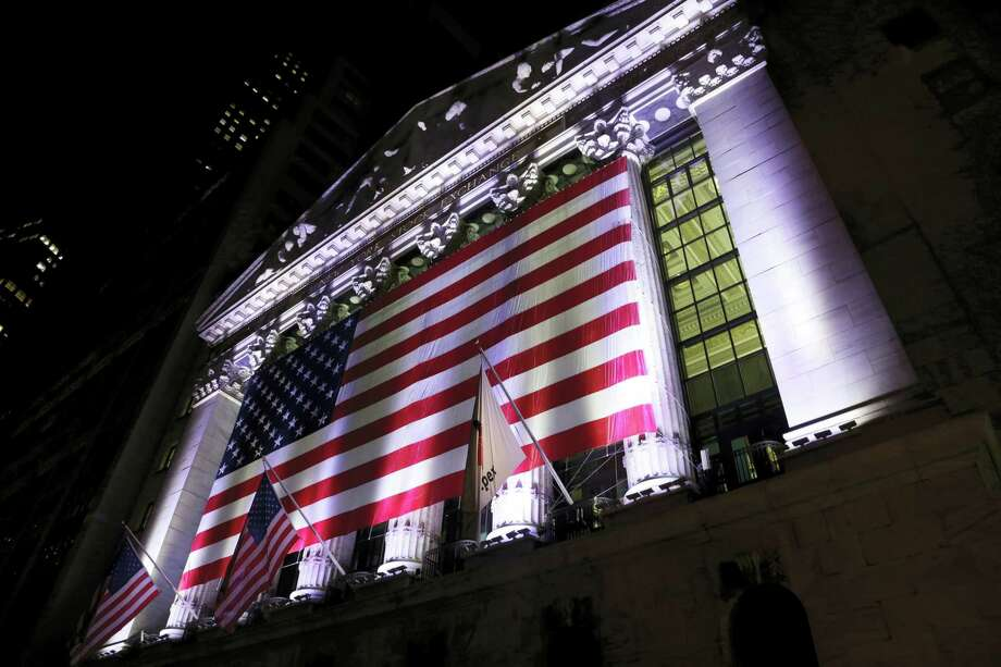 An American flag hangs on the front of the New York Stock Exchange. Photo: Peter Morgan — The Associated Press FILE PHOTO  / Copyright 2017 The Associated Press. All rights reserved.