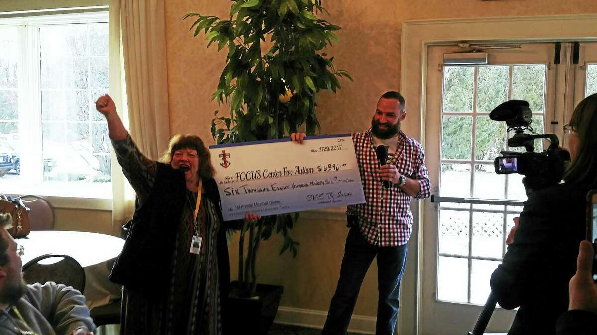 Members of the Bearded Villains' New England Chapter, The Saints, presented a check for $6,896 to the FOCUS Center for Autism after a successful fundraiser dinner in Torrington on Jan. 29.