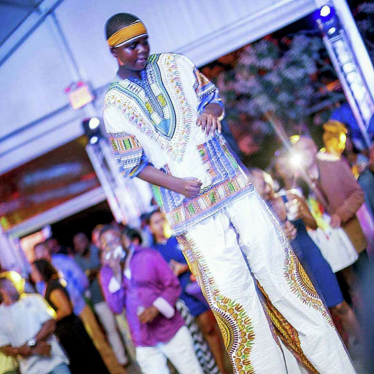 """Nyles Adams, 14, takes part in the Trinidad tradition of stilt-walking, called """"moko jumbies,"""" in this July, 2016 photo at the Marine Park Golf Course in Brooklyn, N.Y. Adams was one of 790 teenagers between the ages of 13 and 17 who participated in a first-of-its-kind Associated Press-NORC Center for Public Affairs Research poll on teens' social media use, political views and political outlook. (Desma Bidjou via AP)"""