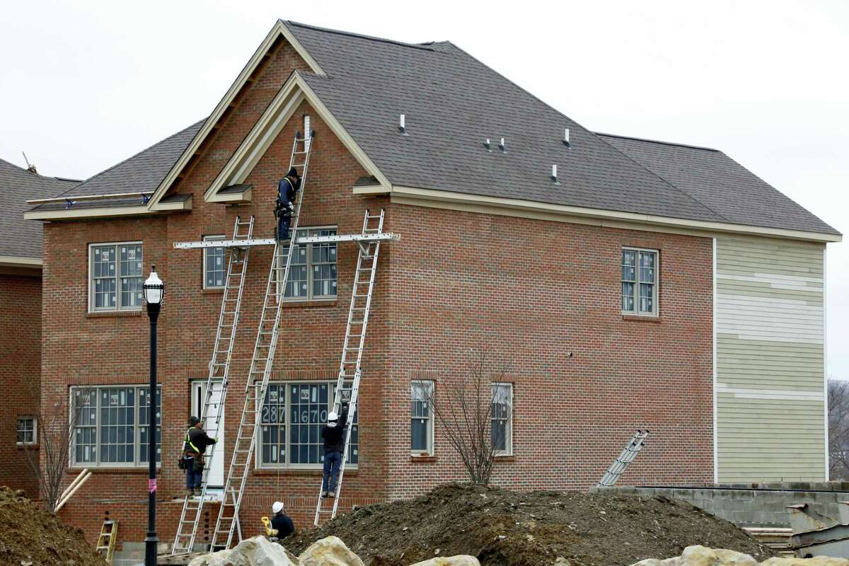 In this Jan. 18, 2017 photo, work continues on a new home under construction in Pittsburgh. U.S. homebuilders are feeling slightly less optimistic about their sales prospects, even as their overall outlook remains favorable. The National Association of Home Builders/Wells Fargo builder sentiment index released Monday, April 17, 2017 slipped to 68 for the month. That's down three points from 71 in March, when it jumped to the highest level since June 2005.