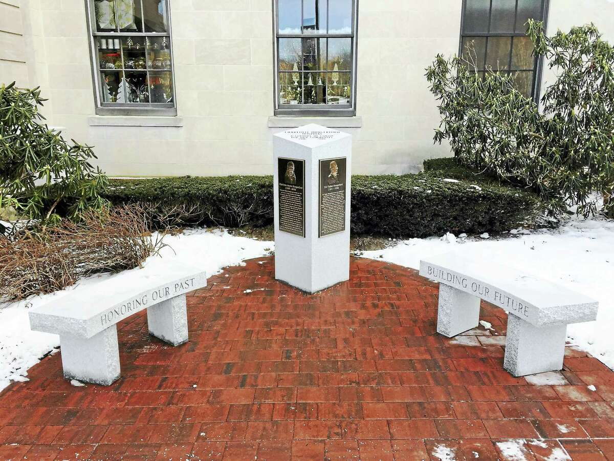A monument marking Charlotte Hungerford Hospital's 100th anniversary stands outside the main building.