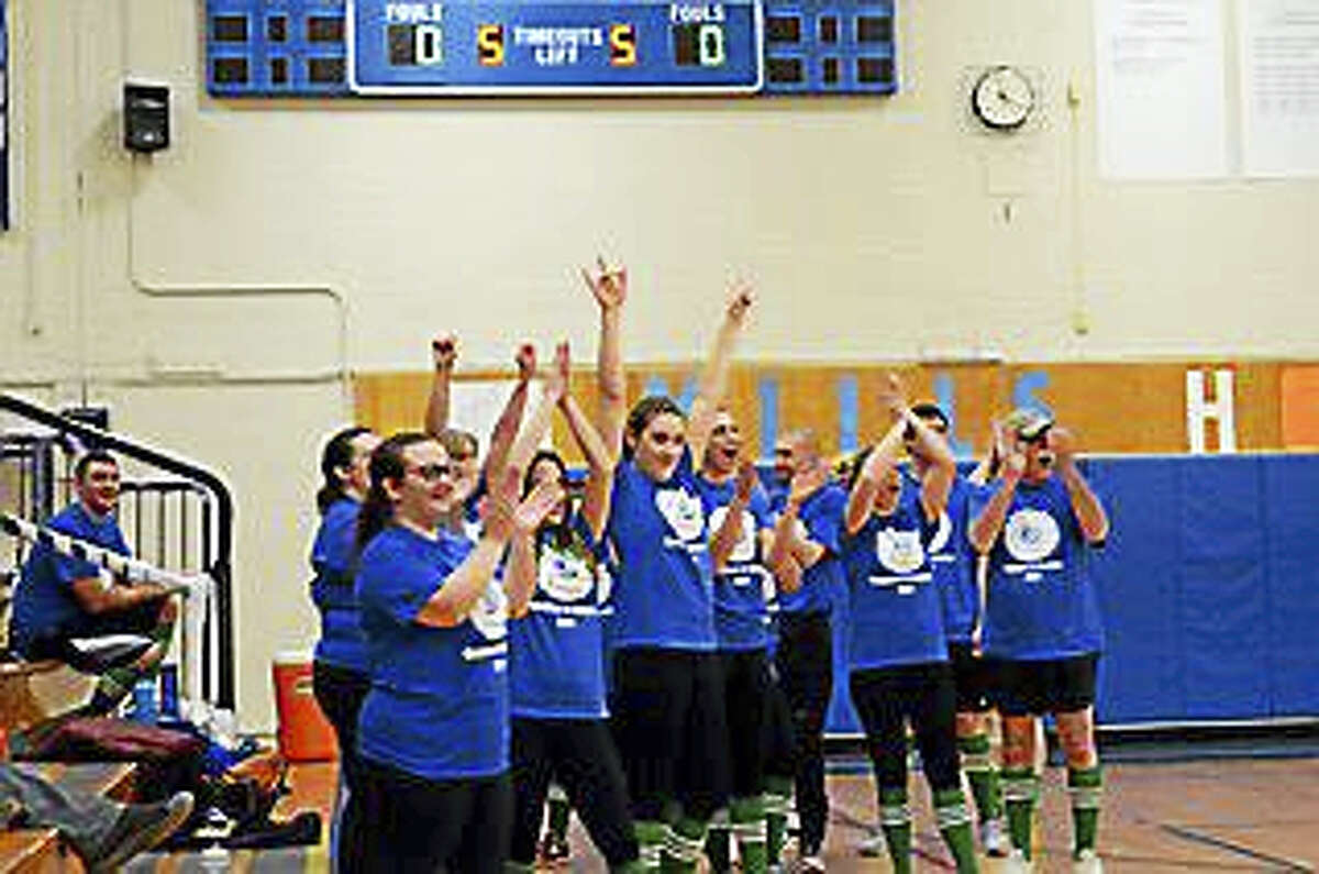 Carolyn Nevin, a sophomore at Lewis S. Mills High School, organized a Coaches vs.Cancer Student vs. Faculty volleyball game to raise donations for her local Relay for Life Team, iCure. The students took the match, winning two of three games, and the event raised $2,500. Carolyn and her team will be participating with over 200 teams from area schools in the annual Relay For Life Cancer Walk on Saturday, May 20th at the Farmington Polo Grounds. Photos: TGN_2957 is Team iCure TGN_3050 is the staff team celebrating a win TGN_3676 is the student team celebrating in front of a large crowd at Mills PVR:184410