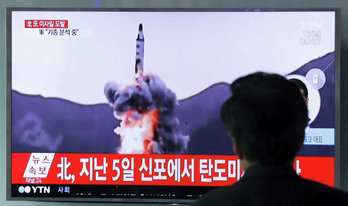 """A man watches a TV showing file footage of a North Korea's ballistic missile at Seoul Railway Station in Seoul, South Korea on April 16, 2017. A North Korean missile exploded during launch Sunday from the country's east coast, U.S. and South Korean officials said, a high-profile failure that comes as a powerful U.S. aircraft carrier approaches the Korean Peninsula in a show of force. The letters on the top read """"North Korea, Fire missile."""""""