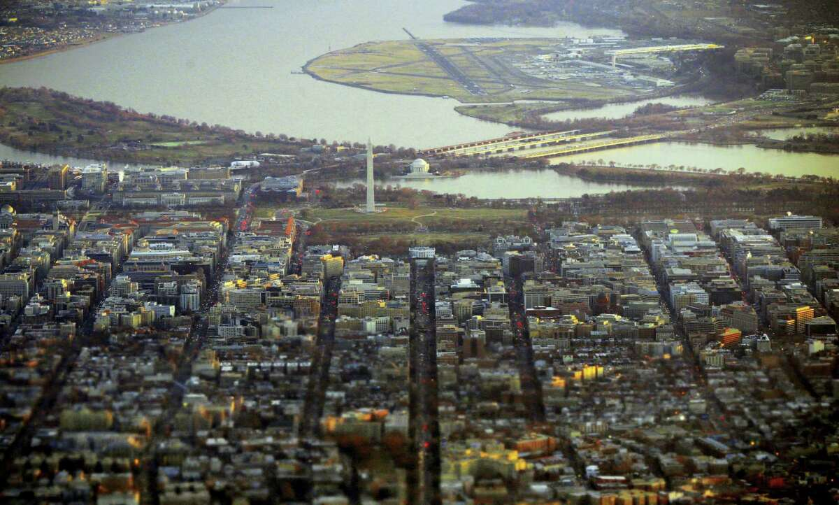 This photo taken Jan. 4, 2013 shows the White House, Washington Monument, Jefferson Memorial, downtown Washington and Ronald Reagan National Airport. Washington, that swampy den of iniquity that politicians love to scorn, sends the most tax dollars per person to the U.S. government.