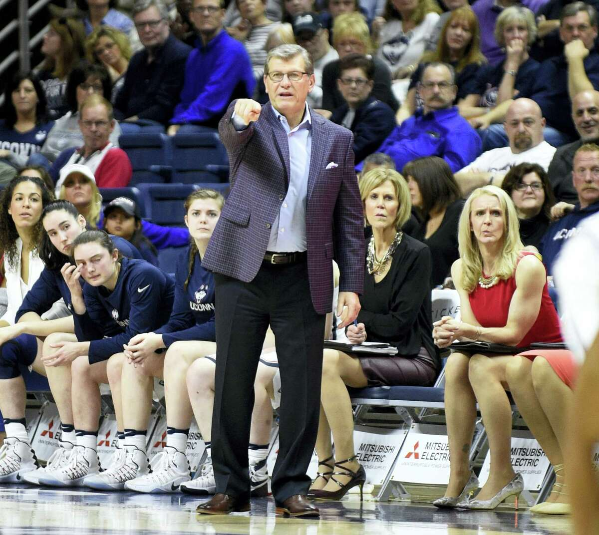 UConn coach Geno Auriemma signals to his team during Saturday's win over Memphis.