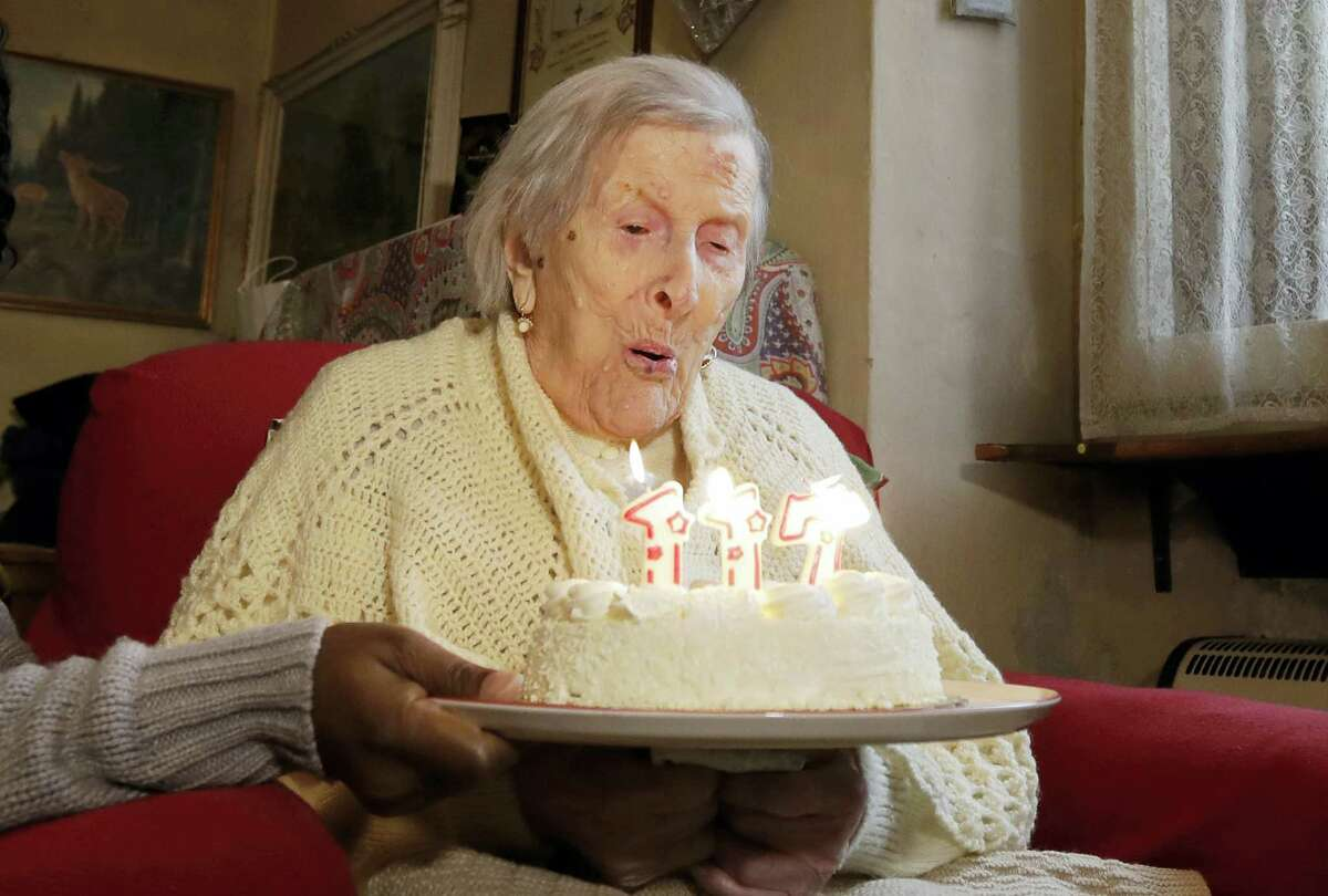 In this Nov. 29, 2016 photo, Emma Morano, 117 years old, blows candles on the day of her birthday in Verbania, Italy. An Italian doctor says Saturday, April 15, 2017 Emma Morano, at 117 the world's oldest person, has died in her home in northern Italy. Dr. Carlo Bava told The Associated Press by telephone that Morano's caretaker called him to say the woman had passed away Saturday afternoon while sitting in an armchair in her home in Verbania, a town on Lake Maggiore.
