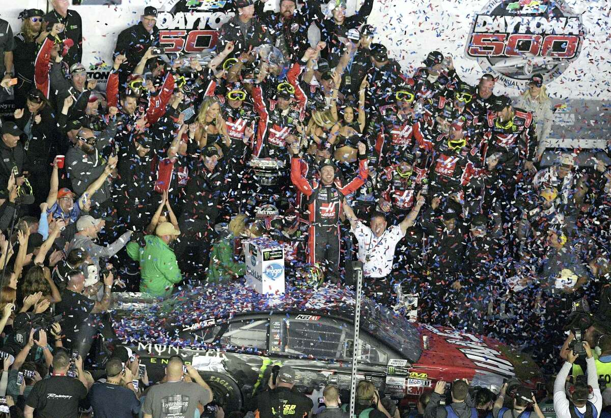 Kurt Busch celebrates with members of his team in Victory Lane after winning the Daytona 500 on Sunday.