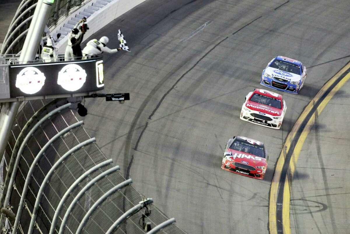 Kurt Busch (41) takes the checkered flag to win the Daytona 500 Sunday.