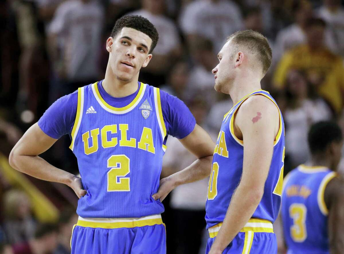 UCLA guard Lonzo Ball (2) and guard Bryce Alford talk during a recent game.