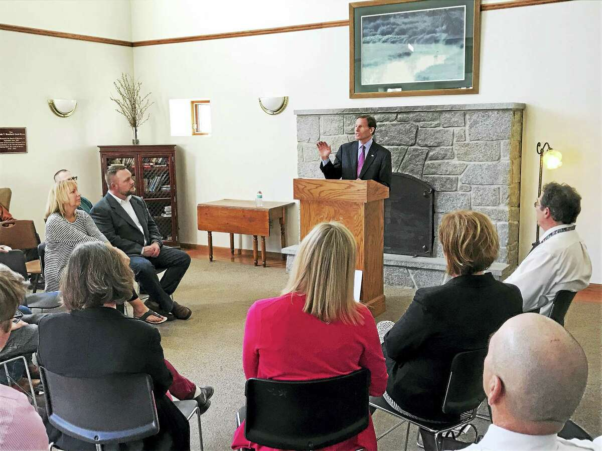 Contributed photosStaff and visitors at the McCall Center for Behavioral Health in Torrington listen to U.S. Sen. Richard Blumenthal during his visit to the center on Friday.
