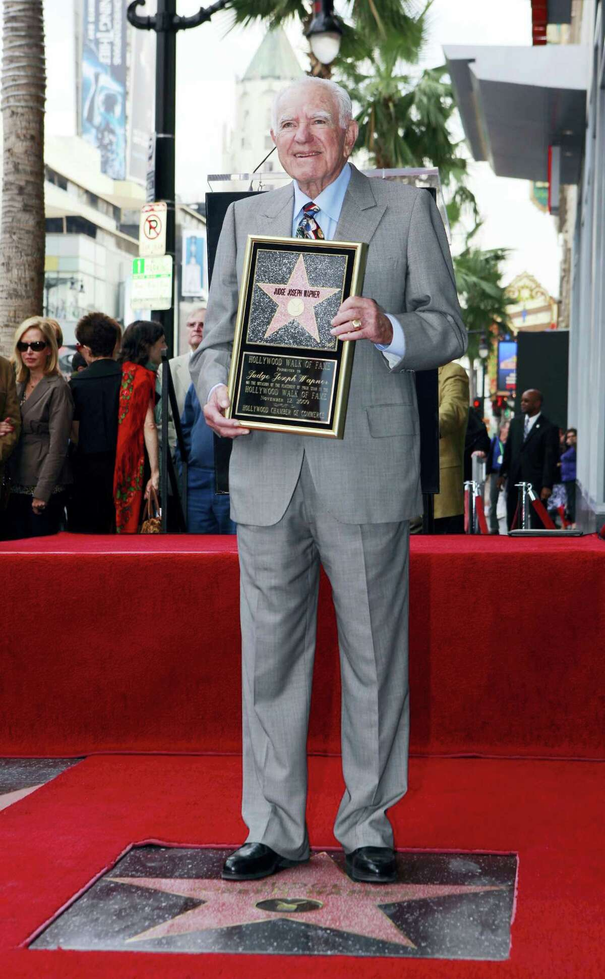 """In this Nov. 12, 2009 photo, Judge Joseph Wapner is honored with star on the Hollywood Walk of Fame in Los Angeles. Wapner, who presided over """"The People's Court"""" with steady force during the heyday of the reality courtroom show, has died. Wapner died at home in his sleep on Feb. 26, 2017, according to his son, David Wapner."""
