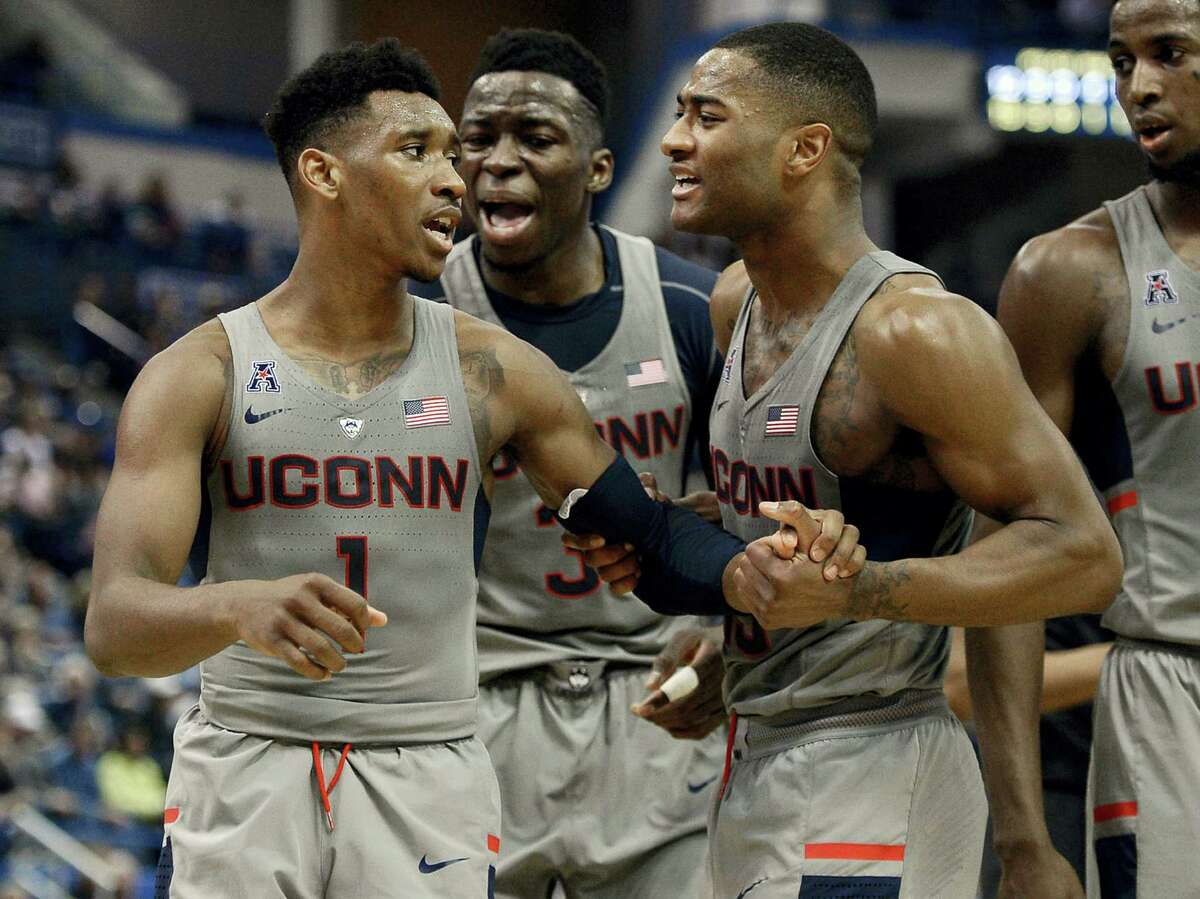 UConn's Rodney Purvis, right, and Amidah Brimah, center, encourage teammate Christian Vital as he reacts in frustration during the first half Saturday in Hartford.