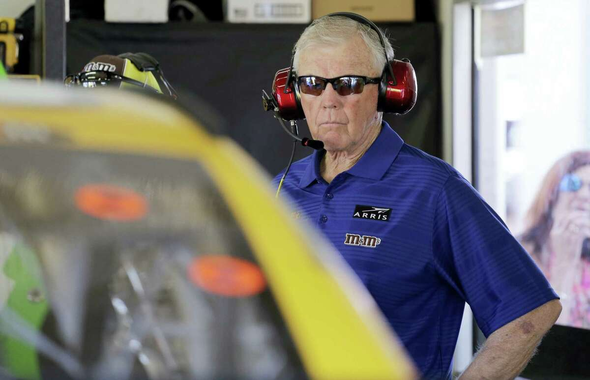 Team owner Joe Gibbs watches crew members work on a car during practice for Sunday's Daytona 500.
