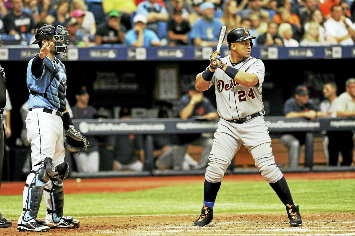 Tampa Bay Rays catcher Curt Casali, left, calls for an intentional walk on the Tigers' Miguel Cabrera during a game last season.