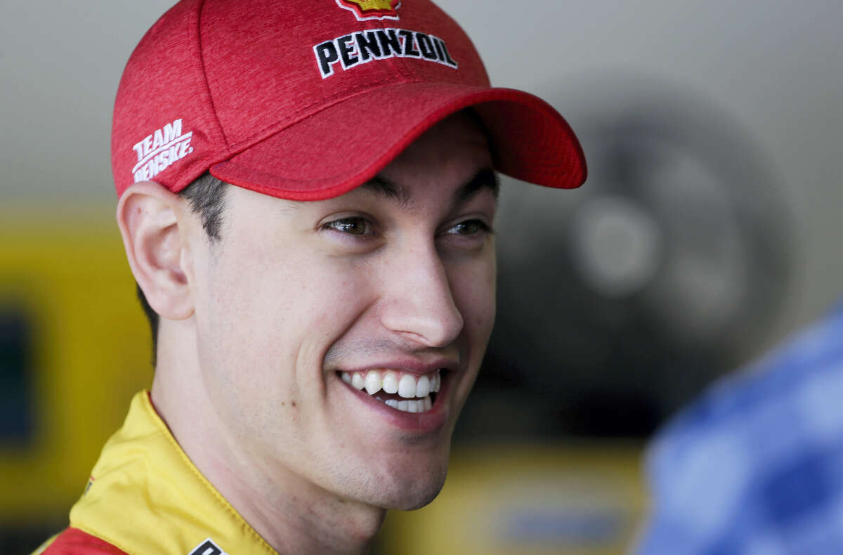 Joey Logano talks in his garage at a practice session at Daytona International Speedway on Friday.